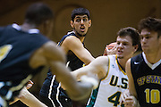 San Francisco State center AJ Kahlon (24) looks for an open teammate against the San Francisco Dons at Kezar Pavilion in San Francisco, Calif., on December 6, 2016. (Stan Olszewski/Special to S.F. Examiner)