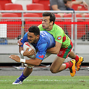Siaosi Asofolau scores Manu Samoa last second half try in their 28-12 victory over Portugal in the Singapore 7's, day 1, Singapore National Stadium, Singapore.  Photo by Barry Markowitz, 4/16/16