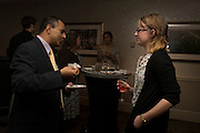 Dr. Julio Arauz and senior Cutler Scholar Caitlyn John share a drink before sitting down to their celebratory dinner. © Ohio University / Photo by Olivia Wallace