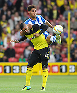 Picture by David Horn/Focus Images Ltd +44 7545 970036<br /> 28/09/2013<br /> Lewis McGugan of Watford and Ryan Shotton of Wigan Athletic during the Sky Bet Championship match at Vicarage Road, Watford.
