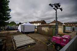© Licensed to London News Pictures. 16/05/2017. London, UK. General view showing the search area. Police continue to search for the body of murdered schoolgirl Danielle Jones at a block of garages in Stifford Clays in Thurrock, Essex. The 15-year-old was last seen on Monday June 18 2001 at about 8am when she left her home in East Tilbury to catch the bus to school.  Photo credit: Ben Cawthra/LNP