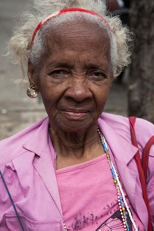 Portrait of an old Cuban lady at a public Wifi square in Centro Habana, in Havana, Cuba.