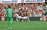 10.03.2013 Sydney, Australia. Players celebrate the second goal during the Hyundai A League game between Western Sydney Wanderers and Wellington Phoenix FC from the Parramatta Stadium. The Wanderers won 2-1.