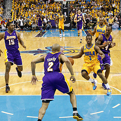 April 22, 2011; New Orleans, LA, USA; New Orleans Hornets point guard Chris Paul (3) drives past Los Angeles Lakers shooting guard Kobe Bryant (24) during the first half in game three of the first round of the 2011 NBA playoffs at the New Orleans Arena. The Lakers defeated the Hornets 100-86.   Mandatory Credit: Derick E. Hingle