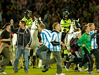 Photo. Jed Wee, Digitalsport<br /> NORWAY ONLY<br /> <br /> Huddersfield Town v Lincoln City, Nationwide League Division Three Playoff Semi-finals Second Leg, 19/05/2004.<br /> Mounted police can only look on as the crowd stream onto the field.