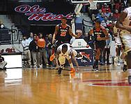 "Ole Miss' Terry Brutus (25) vs. Auburn forward Jordan Granger (25) at the C.M. ""Tad"" Smith Coliseum on Saturday, February 23, 2013.  (AP Photo/Oxford Eagle, Bruce Newman)"