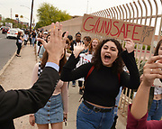 Hundreds of Tucson High School students walk out of class in Tucson, Arizona, USA, on March 14, 2018, in remembrance of victims of the shooting at Marjory Stoneman Douglas High School in Parkland, Florida.  The students held 17 minutes of silence in memory of the 17 students and staff who died in the shooting.
