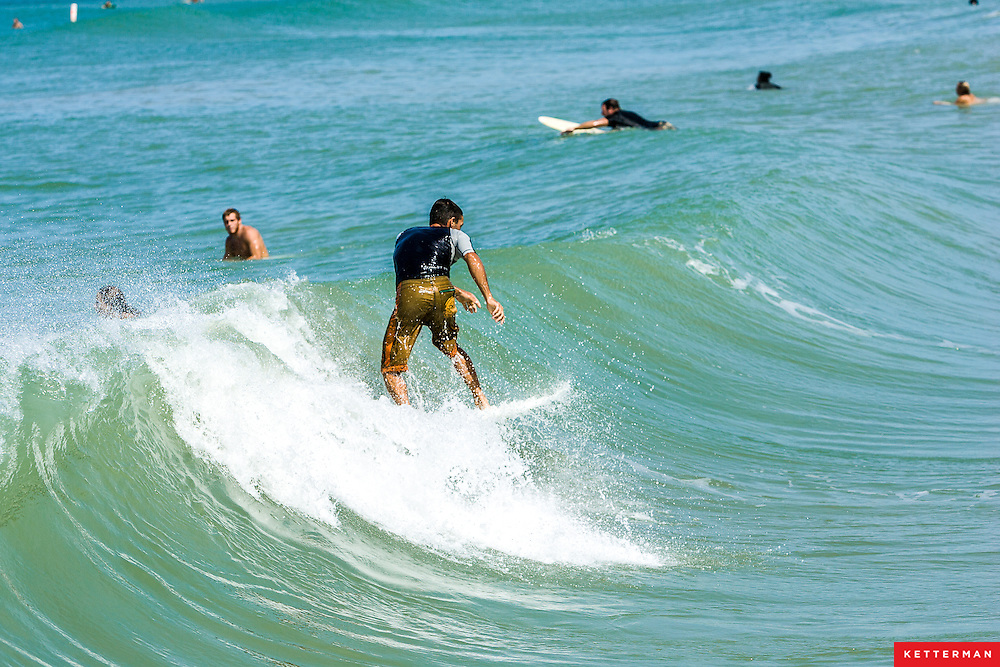 Surfers in Bradenton Beach, Florida take advantage of the leftover surf from Hurricane Gustav.