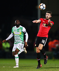 Michael Carrick of Manchester United and Francois Zoko of Yeovil Town- Rogan/JMP - 26/01/2018 - FOOTBALL - Huish Park - Yeovil, England - Yeovil Town v Manchester United - FA Cup Fourth Round.