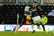 Roger Johnson gets to the ball ahead of Darren Bent during the Sky Bet Championship match between Derby County and Charlton Athletic at the iPro Stadium, Derby, England on 24 February 2015. Photo by Simon Kimber.