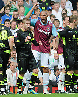 Football - West ham United v Leeds United John Carew (West ham) argues with Leeds players 22/08/2011 Credit : Colorsport / Andrew Cowie