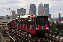 © Licensed to London News Pictures. 23/08/2012, London, UK.  A DLR train arrives at Pontoon Dock station in east London, Thursday, Aug. 23, 2012. DLR, Docklands Light Railway, celebrates its 25th annivesary today. Photo credit : Sang Tan/LNP