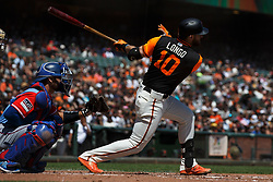 SAN FRANCISCO, CA - AUGUST 26: Evan Longoria #10 of the San Francisco Giants hits a triple against the Texas Rangers during the first inning at AT&T Park on August 26, 2018 in San Francisco, California. The San Francisco Giants defeated the Texas Rangers 3-1. All players across MLB will wear nicknames on their backs as well as colorful, non-traditional uniforms featuring alternate designs inspired by youth-league uniforms during Players Weekend. (Photo by Jason O. Watson/Getty Images) *** Local Caption *** Evan Longoria