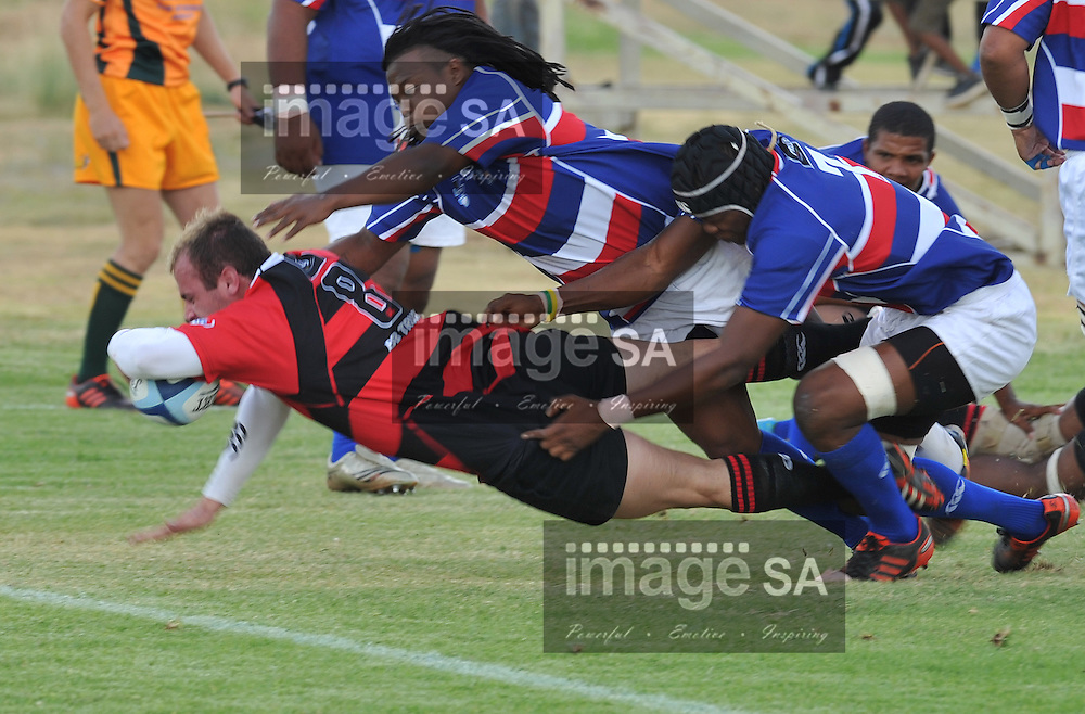 BLOEMFONTEIN, SOUTH AFRICA - Saturday 16 March 2013, Tienie J v Rensburg number eight for Noordelikes, Jerome Raffie hooker for Bloemfontein Crusaders, Msoeu Maruping right flanker for Bloemfontein Crusaders during match 38 of the Cell C Community Cup rugby match between Bloemfontein Crusaders and Noordelikes held at the Clive Solomon stadium, Bloemfontein..Photo by ImageSA