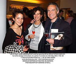 Left to right, MISS COCO BAYLEY and her parents MR & MRS STEPHEN BAYLEY, he is the design consultant, at a party in London on 12th May 2004.PUC 38