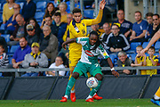 Oxford United defender Curtis Nelson (5) holds back Plymouth Argyle defender Tafari Moore (22) during the EFL Sky Bet League 1 match between Oxford United and Plymouth Argyle at the Kassam Stadium, Oxford, England on 13 October 2018.