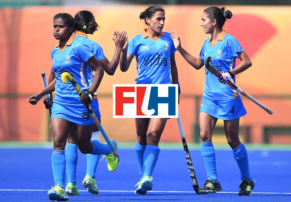 India's Rani (L) runs after scoring a goal during the women's field hockey Japan vs India match of the Rio 2016 Olympics Games at the Olympic Hockey Centre in Rio de Janeiro on August, 7 2016. / AFP / MANAN VATSYAYANA        (Photo credit should read MANAN VATSYAYANA/AFP/Getty Images)