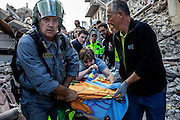 24 August 2016, Amatrice Italy - Rescue teams save a woman after a 6.3 earthquake hit the town of Amatrice in Lazio region killing more than 240 people. Many other towns of the italian central regions have been hit by the quake. There are still many missing people under the rubble.