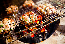 Small herbed pork patties BBQ in a street restaurant, Hanoi, Vietnam, Southeast Asia.