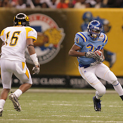 2008 November, 29: Southern University running back Brian Threat (34) runs with the ball as Grambling State safety T.J. McCord (16) closes in on the play during a 29-14 win by Grambling State over Southern University during the 35th annual State Farm Bayou Classic at the Louisiana Superdome in New Orleans, LA.  .