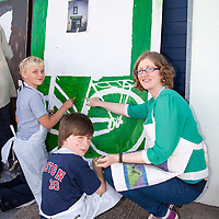 Local Arts Teacher, Mary Fahey, teaching painting during the Ennistymon Boy Scout and Tidy Town Mural Painting