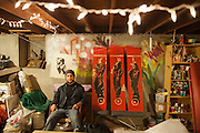 Artist Aron Venegas paints at a friend's studio in El Paso. He is a founding member of Puro Borde, a cross border group of artists in El Paso, USA, and Ciudad Juarez, Mexico.<br /> <br /> His unfinished panels depict murdered bodies being hung from a bridge in Ciudad Juarez by the killers. Aron happened to drive by the scene that day.