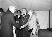 Guests and staff at the US Embassy in Phoenix Park, Dublin, celebrate American Independence Day..1980-07-04.4th July 1980.04/07/1980.07-04-80..Photographed at the US Ambassador's Residence,  Phoenix Park...US Ambassador William V Shannon shakes hands with the wife of Dublin Mayor Fergus O'Brien. ..Mayor of Dublin Fergus O'Brien chats with Elizabeth McNelly Shannon (obscured by her husband) in the marquee during festivities.