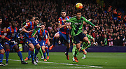 Maya Yoshida and Damien Delaney in an arial battle during the Barclays Premier League match between Crystal Palace and Southampton at Selhurst Park, London, England on 12 December 2015. Photo by Michael Hulf.