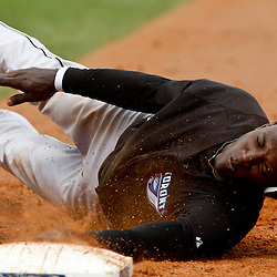 March 8, 2011; Port Charlotte, FL, USA; Toronto Blue Jays shortstop Adeiny Hechavarria (3) dives back to first base on an attempted pick off play during a spring training exhibition game against the Tampa Bay Rays at Charlotte Sports Park.   Mandatory Credit: Derick E. Hingle