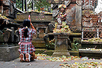 Woman Praying in Ubud.<br />