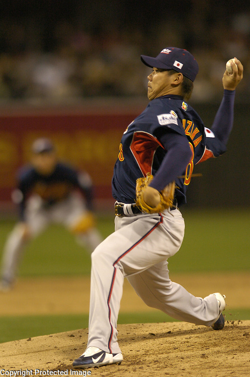 in Final action of the World Baseball Classic at PETCO Park, San Diego, CA.