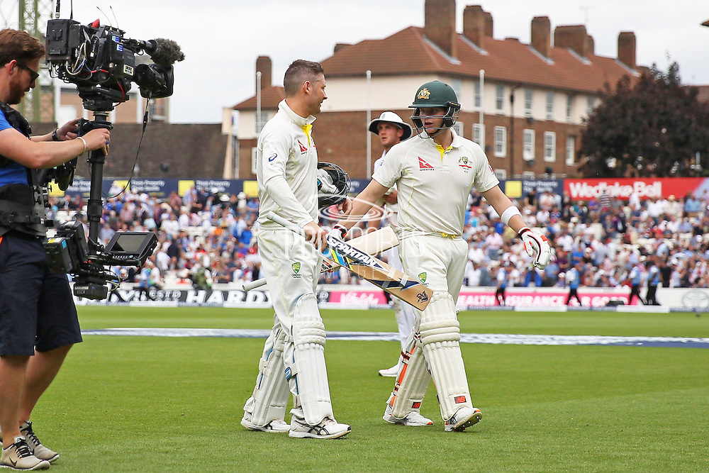 Michael Clarke captain of Australia and Steven Smith of Australia leave the pitch for the Yorkshire tea break during the 1st day of the 5th Investec Ashes Test match between England and Australia at The Oval, London, United Kingdom on 20 August 2015. Photo by Phil Duncan.