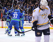VANCOUVER, CANADA - DECEMBER 1: The Vancouver Canucks celelbrate a second period goal on the Nashville Predators at Rogers Arena on December 1, 2011 in Vancouver, British Columbia, Canada. Nashville won 6-5. (Photo by Derek Leung/Getty Images)