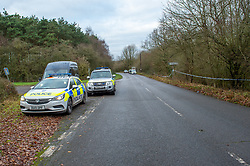 "© Licensed to London News Pictures. 07/12/2019. Gerrards Cross, UK. Police vehicles including a dog unit parked at the corner of Hedgerley Lane and Wapseys Lane as London's Metropolitan Police Service searches woodland in Gerrards Cross, Buckinghamshire. Police have been in the area conducting operations since Thursday 5th December 2019 and are searching two areas on Hedgerley Lane. In a press statement a Metropolitan Police spokesperson said ""Officers are currently in the Gerrards Cross area of Buckinghamshire as part of an ongoing investigation.<br />