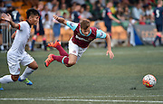 HKFC Citibank Soccer sevens- West Ham vs Hong Kong Football association(HKFA).<br /> HKFA Player Yu Pui Hong (L) trips up West Ham United player Noha Sylvestre