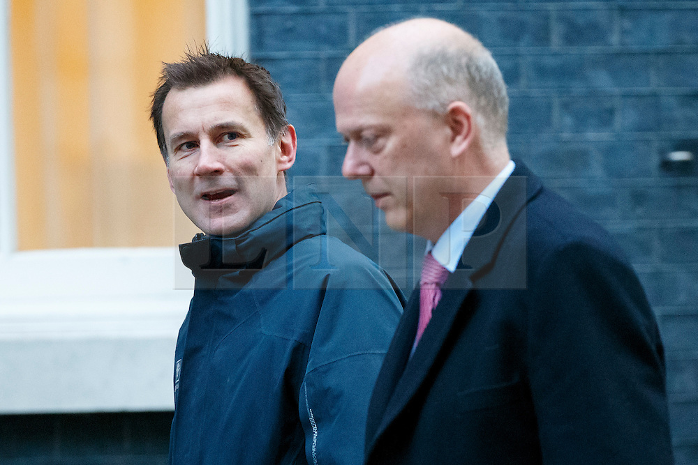© Licensed to London News Pictures. 23/11/2016. London, UK. Health Secretary JEREMY HUNT and Transport Secretary CHRIS GRAYLING attend a cabinet meeting in Downing Street before the autumn statement announment on Wednesday, 23 November 2016. Photo credit: Tolga Akmen/LNP