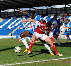 Bristol City's Sam Baldock jostles for the ball with Colchester United's Magnus Okuuonghae - Photo mandatory by-line: Dougie Allward/JMP - Mobile: 07966 386802 22/03/2014 - SPORT - FOOTBALL - Colchester - Colchester Community Stadium - Colchester United v Bristol City - Sky Bet League One