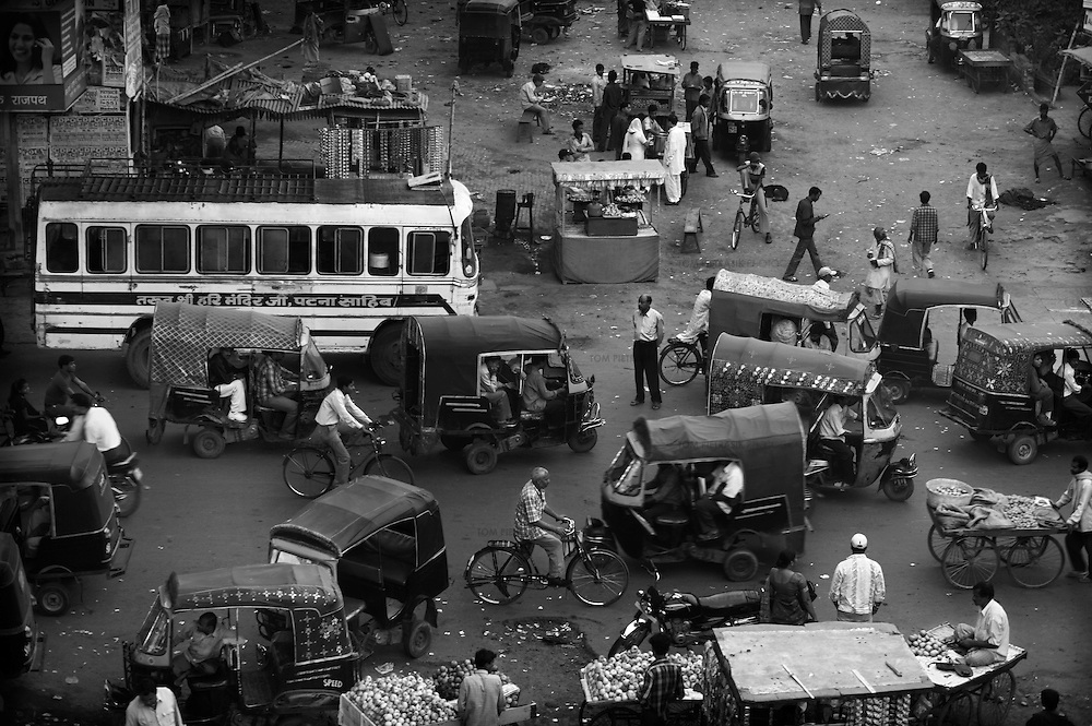 Evening activity at Patna's Gia Ghat neighbourhood, close to the banks of the Ganges river. This area has become an informal terminal where inter-district buses pass into the city. Migrating communities provide potential for the polio virus to spread from district to district and transit points like these are a focus for Unicef's polio vaccination effort...India is one of only four countries in the world reported to suffer endemic polio. Only 66 new cases of the disease were reported in India in 2005. But in 2006 that figure leapt ten-fold. In September, UN Secretary General Kofi Annan wrote to Indian Prime Minister Manmohan Singh expressing concern at the new polio outbreak. The Indian government, together with partners including Unicef and Rotary International has embarked on a renewed effort to eradicate polio. Overcrowded areas of poor sanitation are particularly susceptible to the virus. Focusing on the poor north Indian states of Uttar Pradesh and Bihar which between them are home to more than 250 million people, Unicef is coordinating the largest public health drive in the world. The task is to vaccinate all children under the age of five during a series of vaccination rounds. Unicef has mobilised thousands of volunteers to administer and supervise the vaccination effort. Unicef has also recruited people with influence to encourage communities to have their children protected against polio. Misinformation, rumours and a frustration with the lack of other health services mean that many households, particularly in Muslim areas, resist vaccination. ..Photo: Tom Pietrasik.Patna, Bihar, India..November 17th 2006