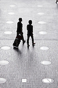 silhouette of two business people