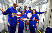 "The Harlem Globetrotters, from left, Jonathan ""Hawk"" Thomas, Ty ""Turbo"" Davis, Deandre ""Dragon"" Taylor, Brawley ""Cheese"" Chisholm and Tammy ""T-Time"" Brawner, pose for a portrait aboard the new Atlanta Streetcar while taking in downtown sights during a demonstration of their basketball handling skills in advance of their Arena at Gwinnett shows during a rare day off, Monday, March 9, 2015, in Atlanta. David Tulis / AJC Special"