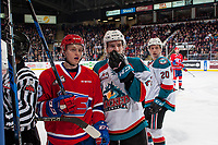 KELOWNA, CANADA - JANUARY 10: Riley Woods #13 of the Spokane Chiefs and James Hilsendager #2 of the Kelowna Rockets stand at the bench watching a player fight on January 10, 2017 at Prospera Place in Kelowna, British Columbia, Canada.  (Photo by Marissa Baecker/Shoot the Breeze)  *** Local Caption ***