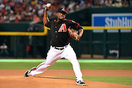 Apr 23, 2016; Phoenix, AZ, USA; Arizona Diamondbacks starting pitcher Rubby De La Rosa (12) delivers a pitch in the first inning against the Pittsburgh Pirates at Chase Field. Mandatory Credit: Jennifer Stewart-USA TODAY Sports