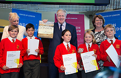 Image ©Licensed to i-Images Picture Agency. 09/07/2014. London, United Kingdom. Mayor launches London Curriculum with University style quiz. Boris Johnson stands with schoolchildren finalist from the London Knowledge Quiz from St. Paul's School  in London Curriculum with University Challenge style quiz for capital's schoolchildren. Museum of London. Picture by Daniel Leal-Olivas / i-Images