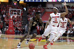 20 March 2017:   Tank Efianayi works against MiKyle McIntosh(11) during a College NIT (National Invitational Tournament) 2nd round mens basketball game between the UCF (University of Central Florida) Knights and Illinois State Redbirds in  Redbird Arena, Normal IL
