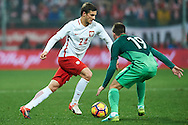 Wroclaw, Poland - 2016 November 14: Bartosz Bereszynski of Poland fights for the ball with Miha Zajc of Slovenia during Poland v Slovenia - International Friendly Soccer Match at Municipal Stadium on November 14, 2016 in Wroclaw, Poland.<br /> <br /> Adam Nurkiewicz declares that he has no rights to the image of people at the photographs of his authorship.<br /> <br /> Picture also available in RAW (NEF) or TIFF format on special request.<br /> <br /> Any editorial, commercial or promotional use requires written permission from the author of image.<br /> <br /> Mandatory credit:<br /> Photo by © Adam Nurkiewicz / Mediasport
