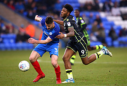 Ellis Harrison of Bristol Rovers takes on Andrew Hughes of Peterborough United - Mandatory by-line: Robbie Stephenson/JMP - 24/03/2018 - FOOTBALL - ABAX Stadium - Peterborough, England - Peterborough United v Bristol Rovers - Sky Bet League One