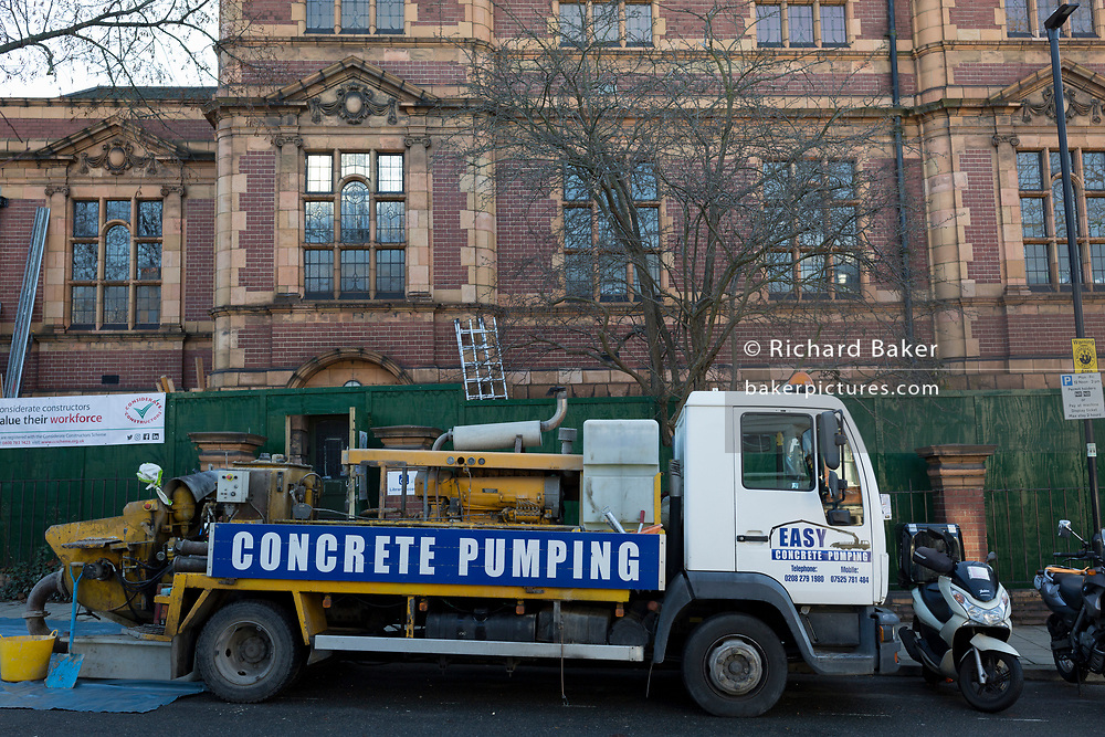 Contractors working for Lambeth Council begin the controversial conversion of carnegie Library into a gym, by pouring concrete into the Grade II listed building, on 18th December 2017, in Herne Hill, south London, England. Shut by Lambeth council and occupied by protesters for 10 days in April, the library which was bequeathed by American philanthropist, Andrew Carnegie has been locked ever since because, say Lambeth austerity cuts are necessary even though 24hr security make it more expensive to keep closed than open for the local community. A gym that locals say they don't want or need is planned to replace the working library and while some of the 20,000 books on shelves will remain, no librarians will be present to administer it.