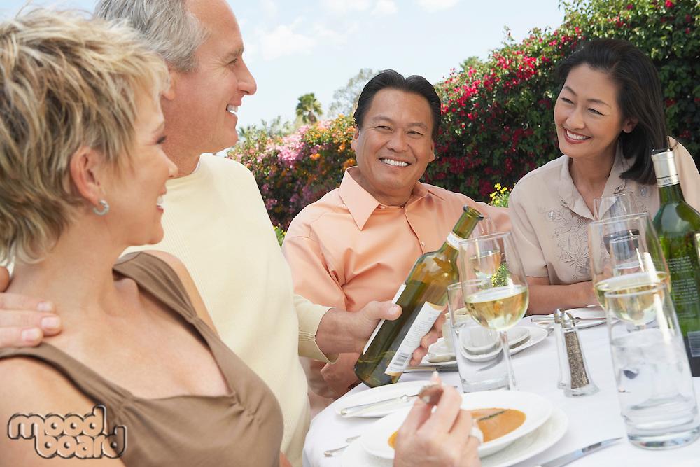 Friends Enjoying a Meal Outdoors