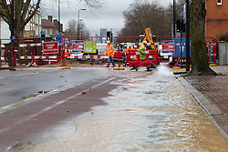 © Licensed to London News Pictures. 28/02/2014. London, UK. Water from a burst watermain is pumped into Clapham Road in Kennington London today (28/02/2014). The watermain, which burst yesterday evening flooding a section of Clapham Road - a major in and out of the city - with thousands of litres of water, has today caused widespread disruption to traffic. Photo credit: Matt Cetti-Roberts/LNP