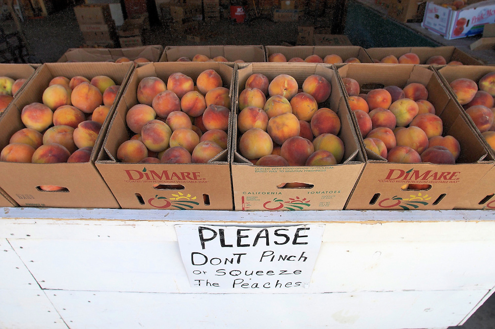Boxes of peaches for sale during peach harvest near Palisade, CO.